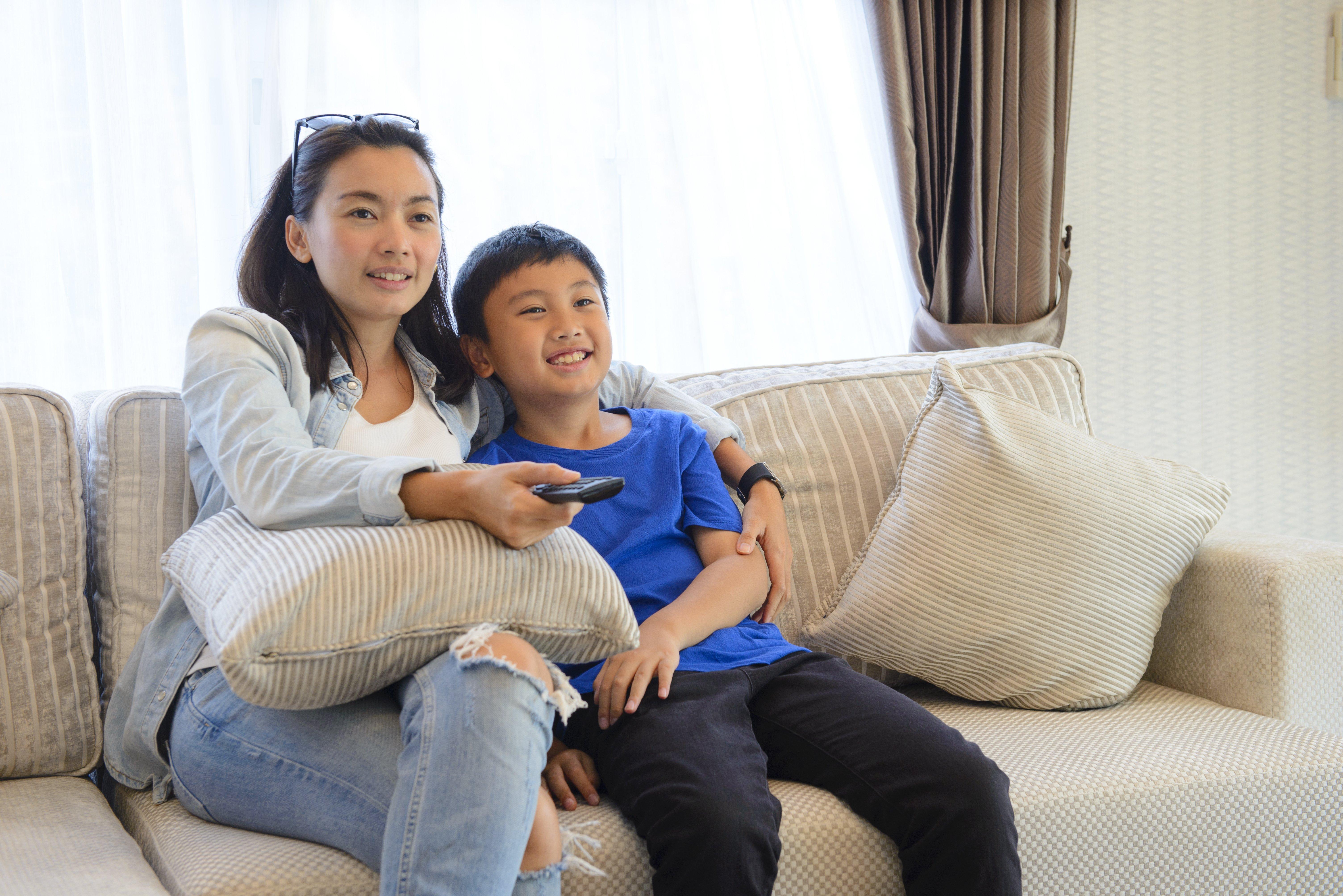 Asian Family Watching TV