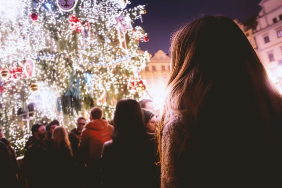 Image of a woman looking at a Christmas tree