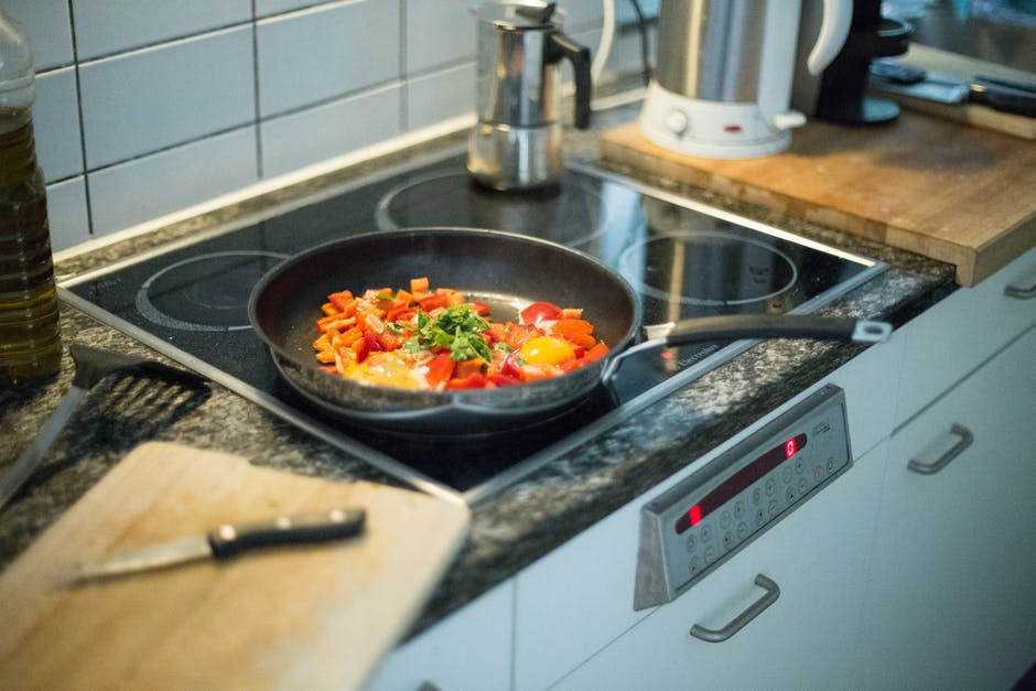 Image of vegetables cooking on a stovetop