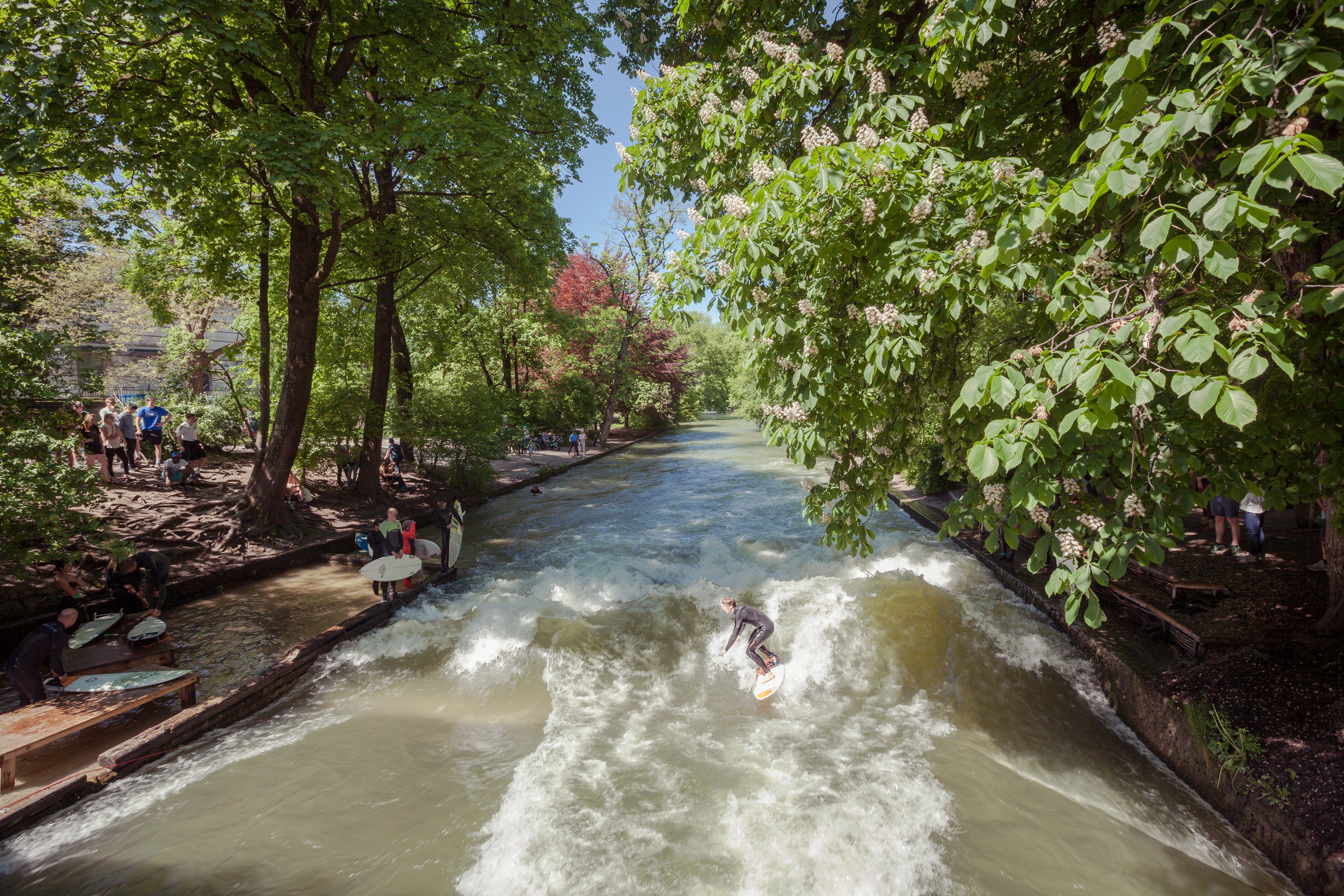 This is an image of surfers in the Englischer Garten in Munich, Germany.