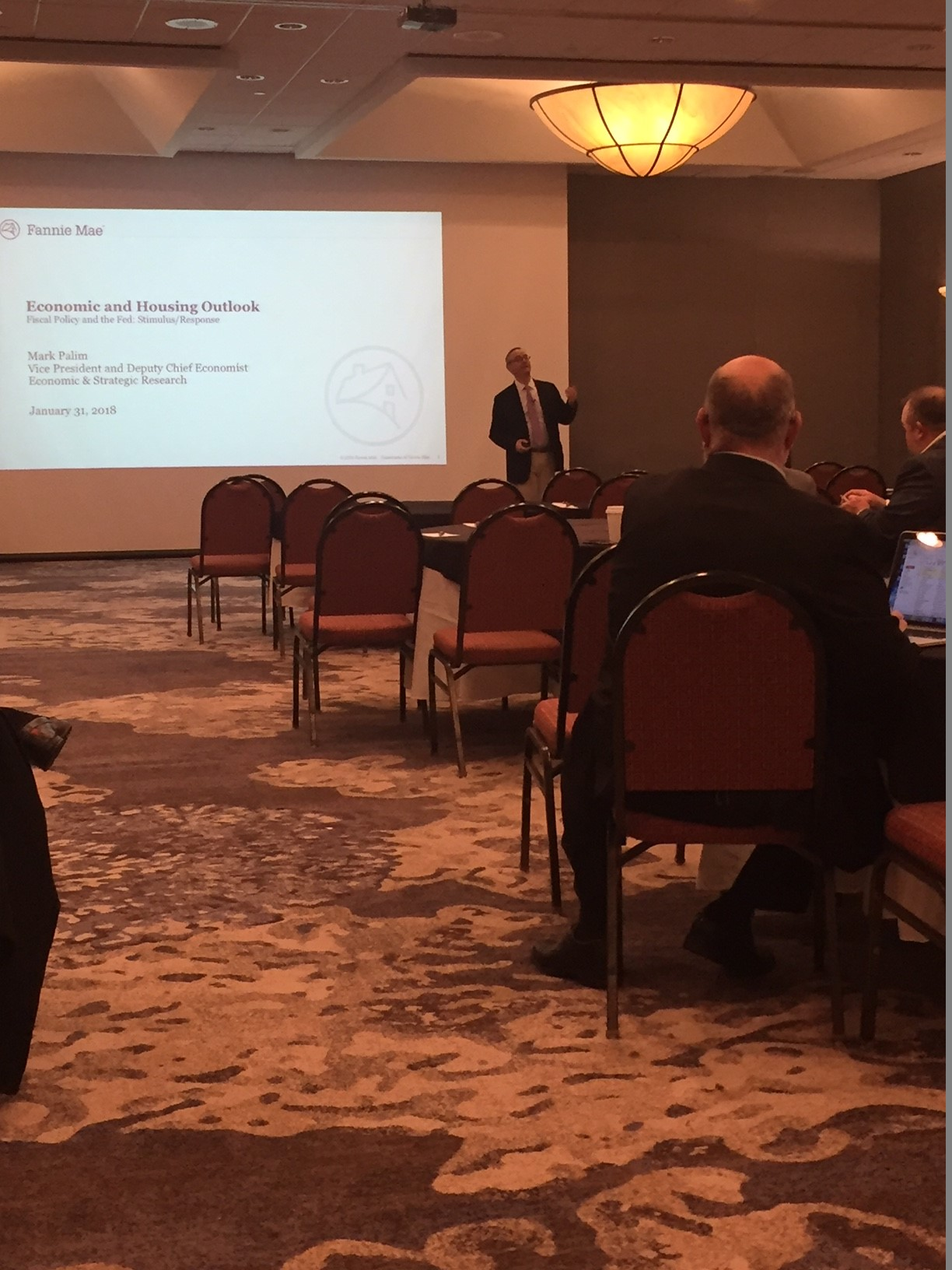 Image of a session about the housing market at the CRN event