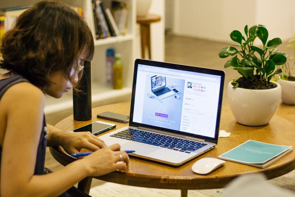 Image of a woman on a laptop
