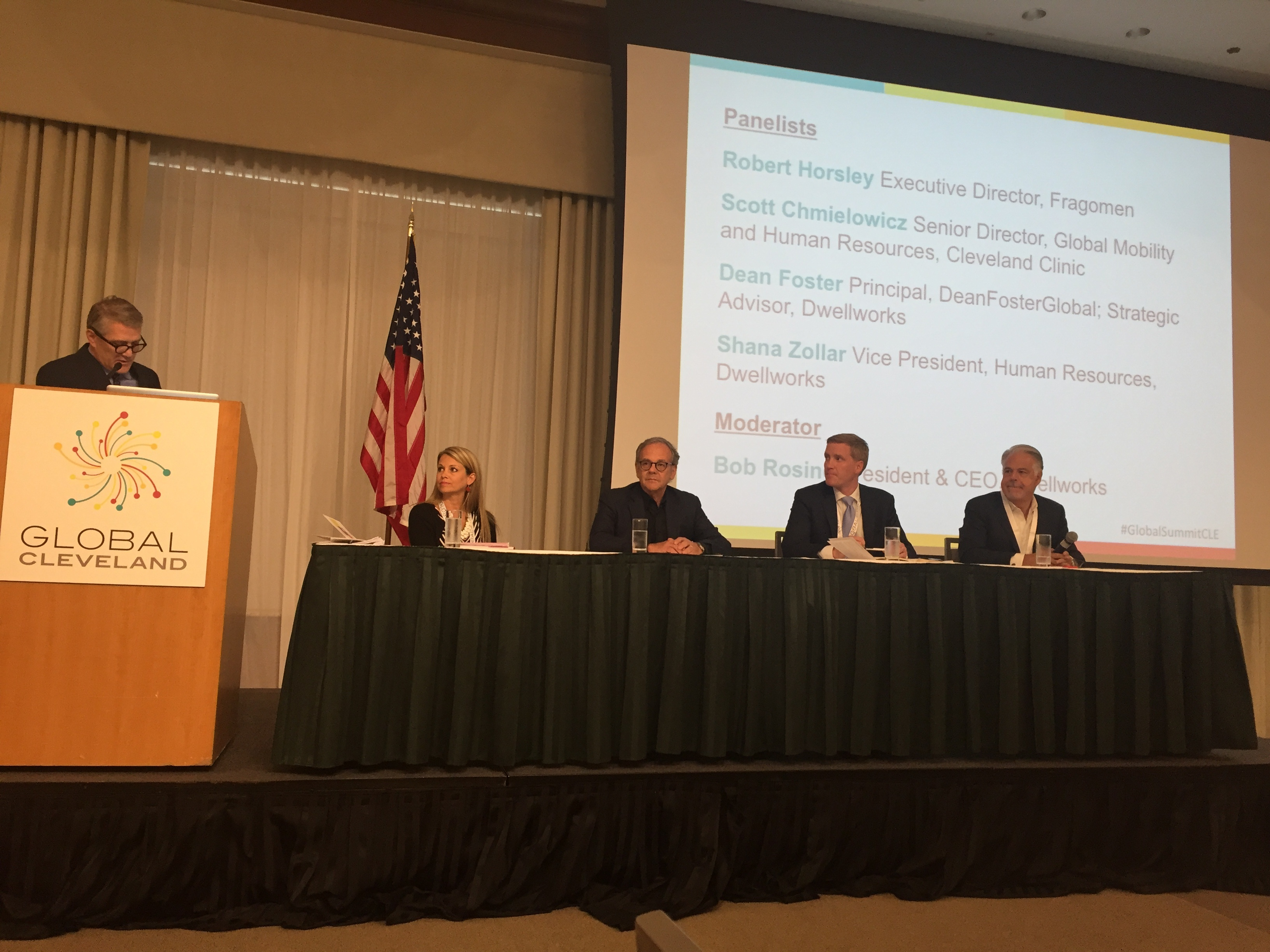 This is an image of the Dwellworks team participating on a panel which focused on the importance of global teams.