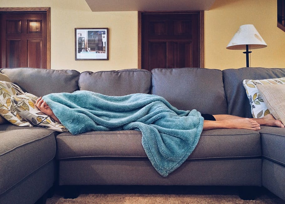 Image of a person sleeping on a couch