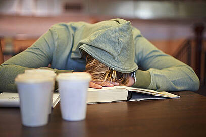 Image of a woman sleeping on a book