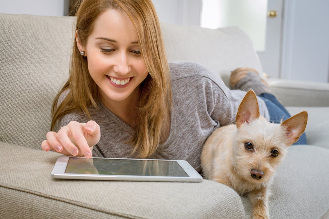 An image of a woman with her dog in corporate housing