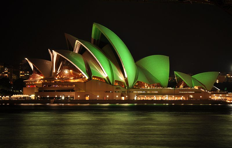 Image of the Sydney Opera House glowing green