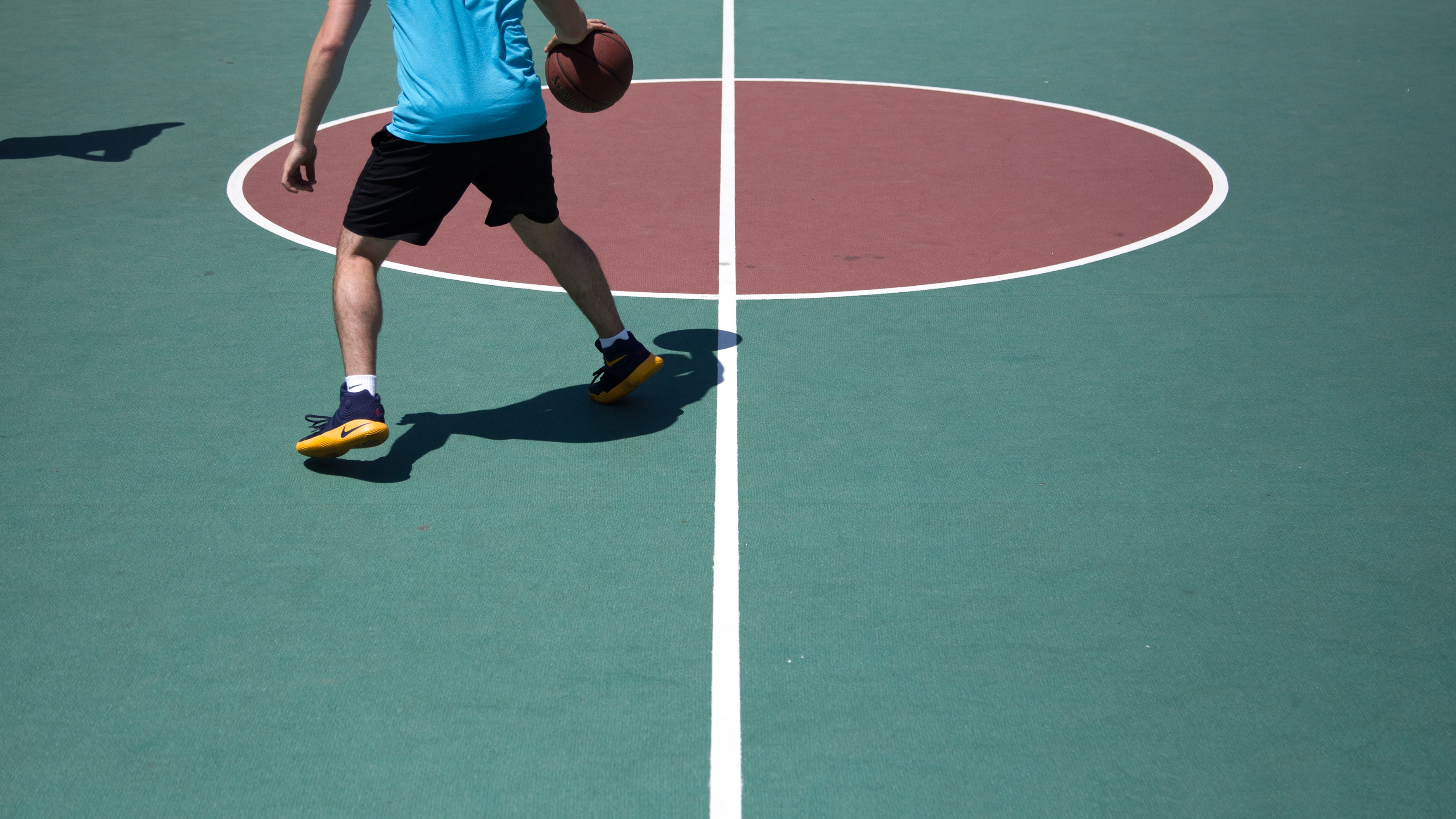 Image of a basketball player dribbling across cultures