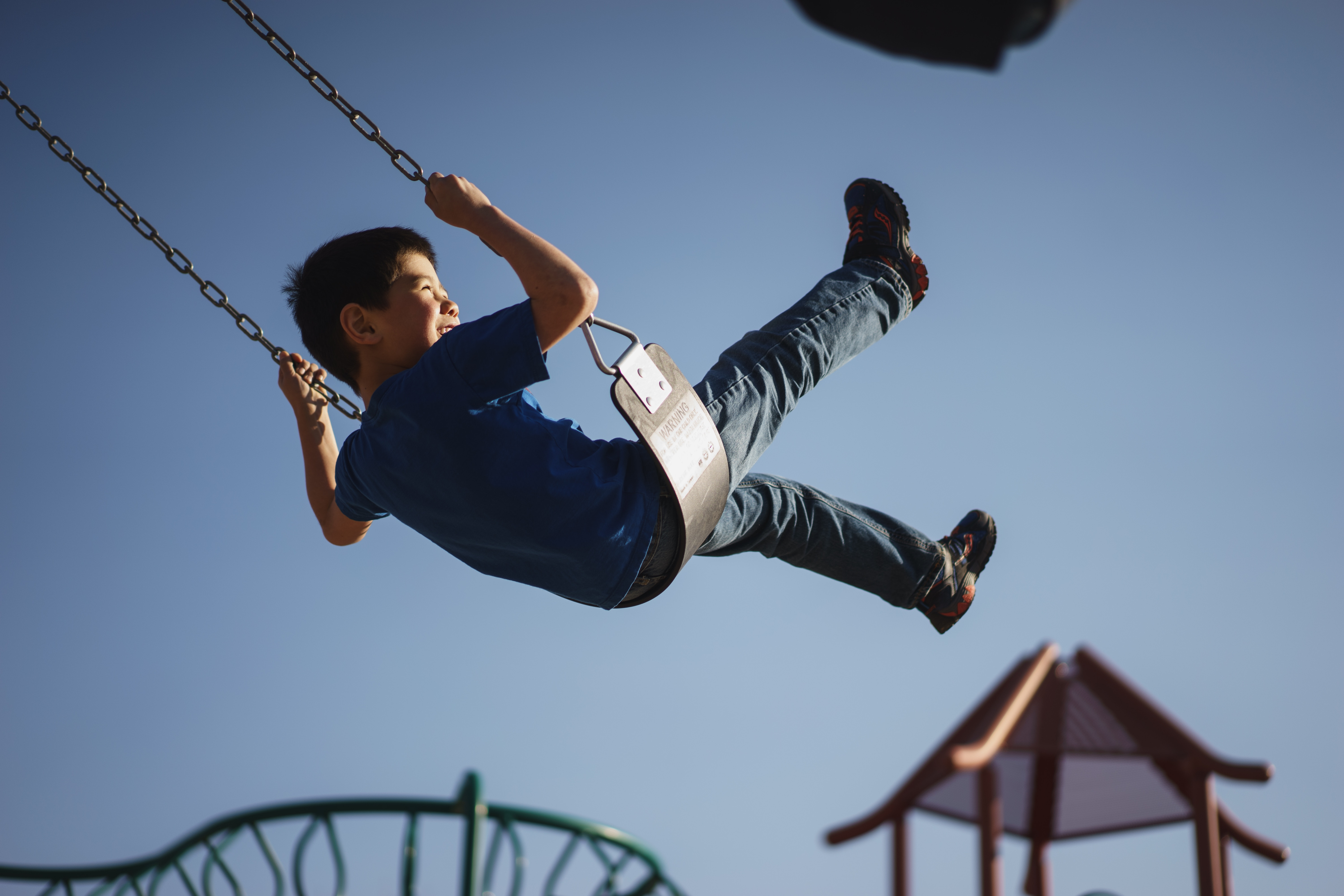 Image of a child playing in their new community