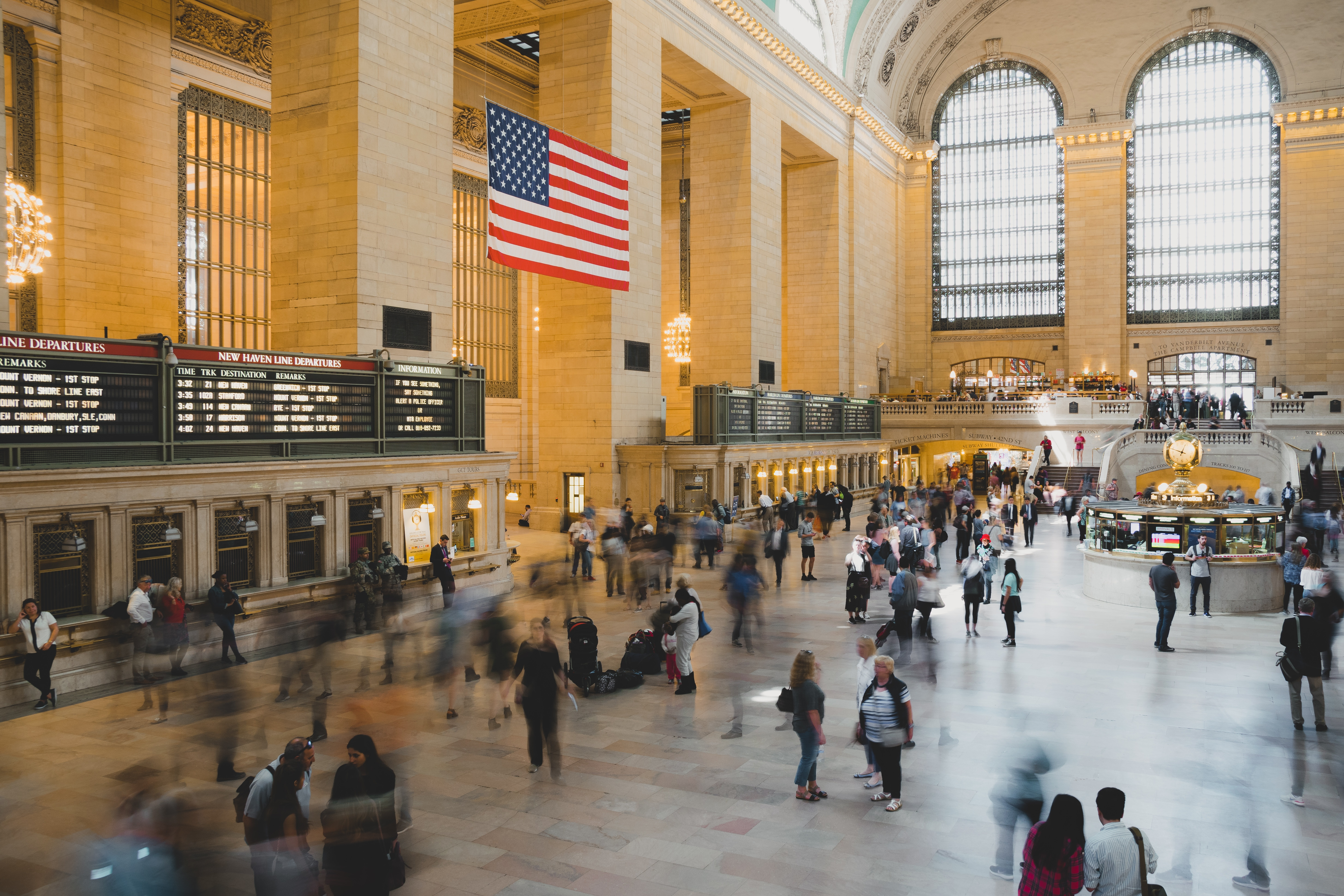 Image of business travelers passing through Grand Central Station