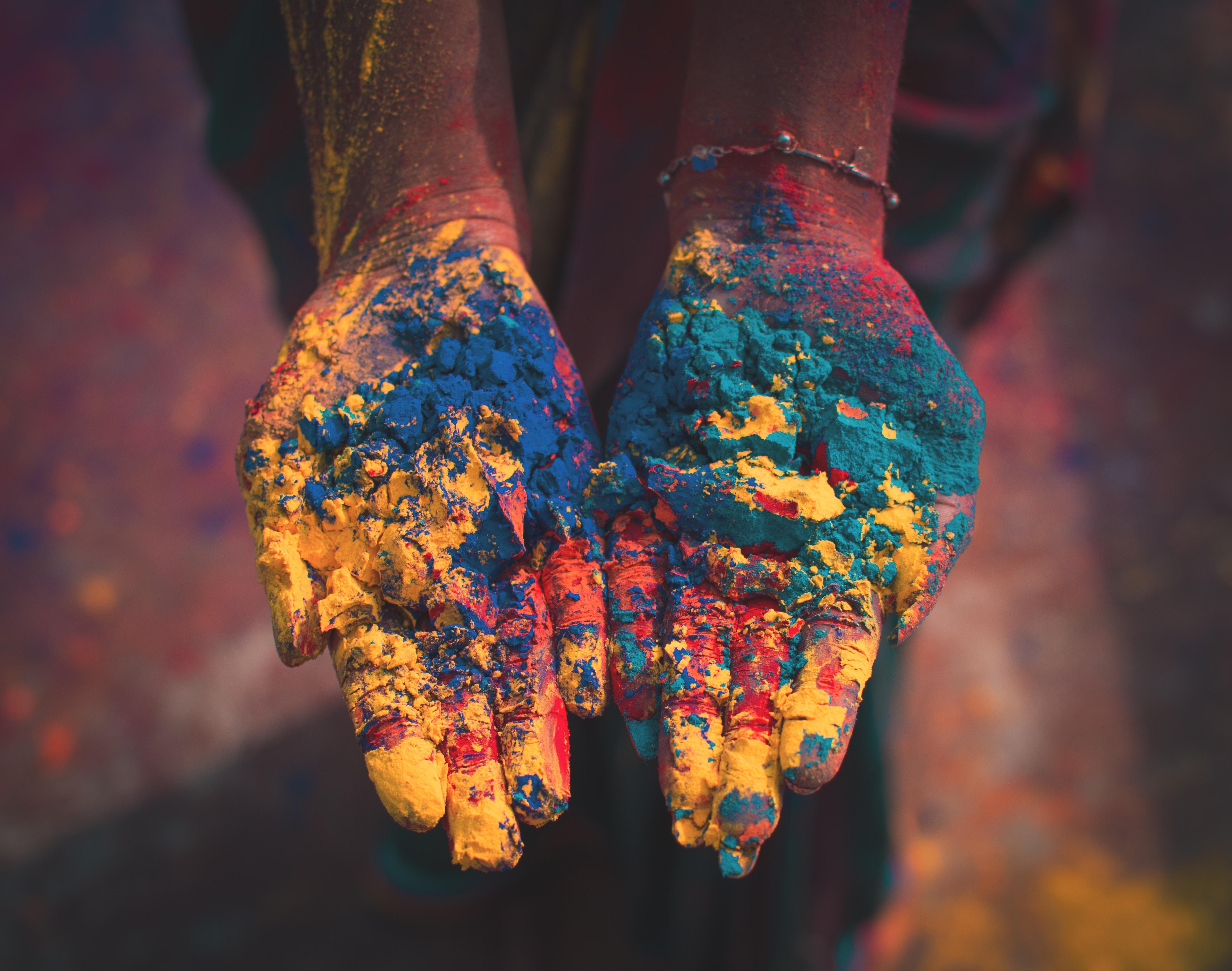 Image of hands holding Holi powder