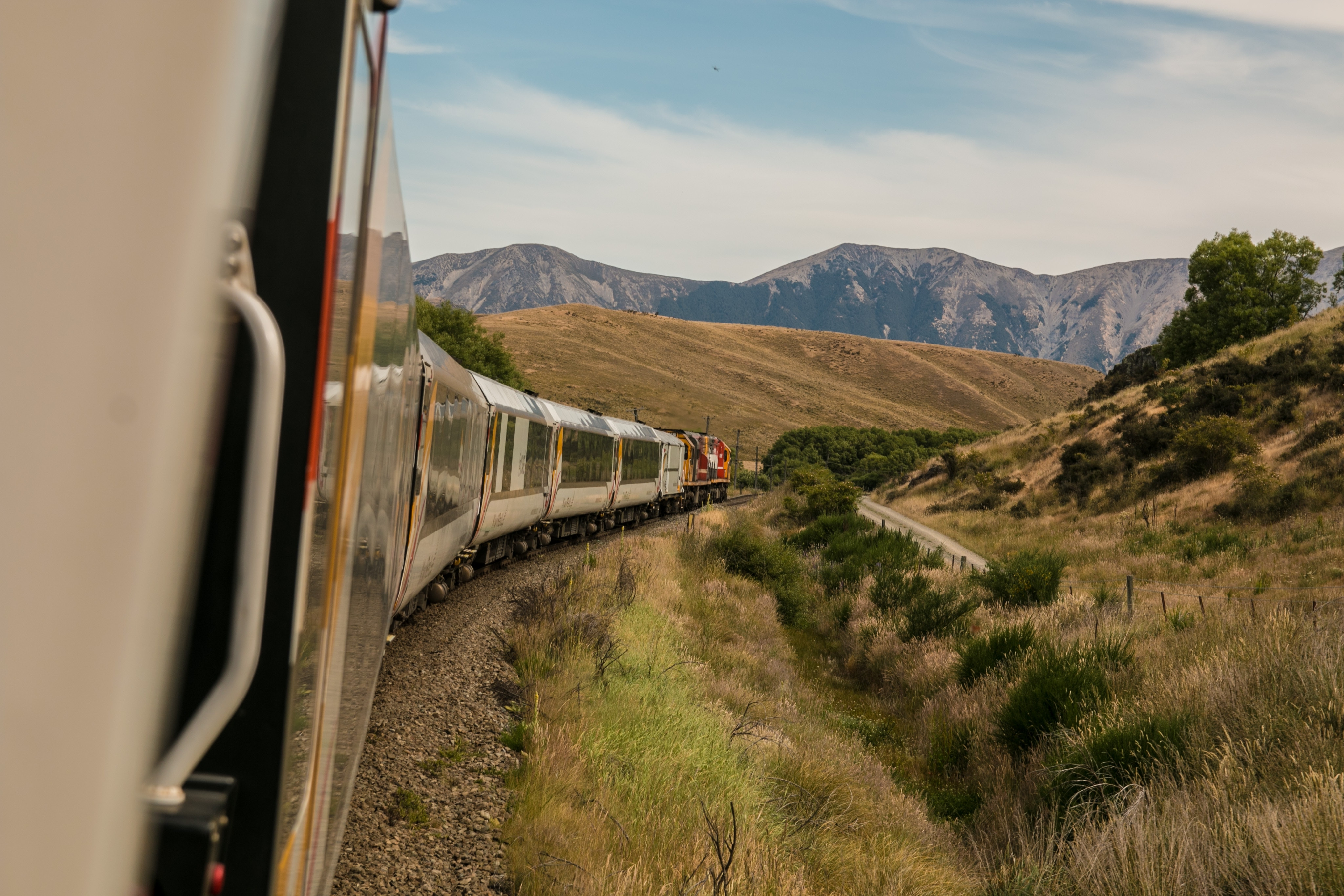 Image of a train traveling through the countryside
