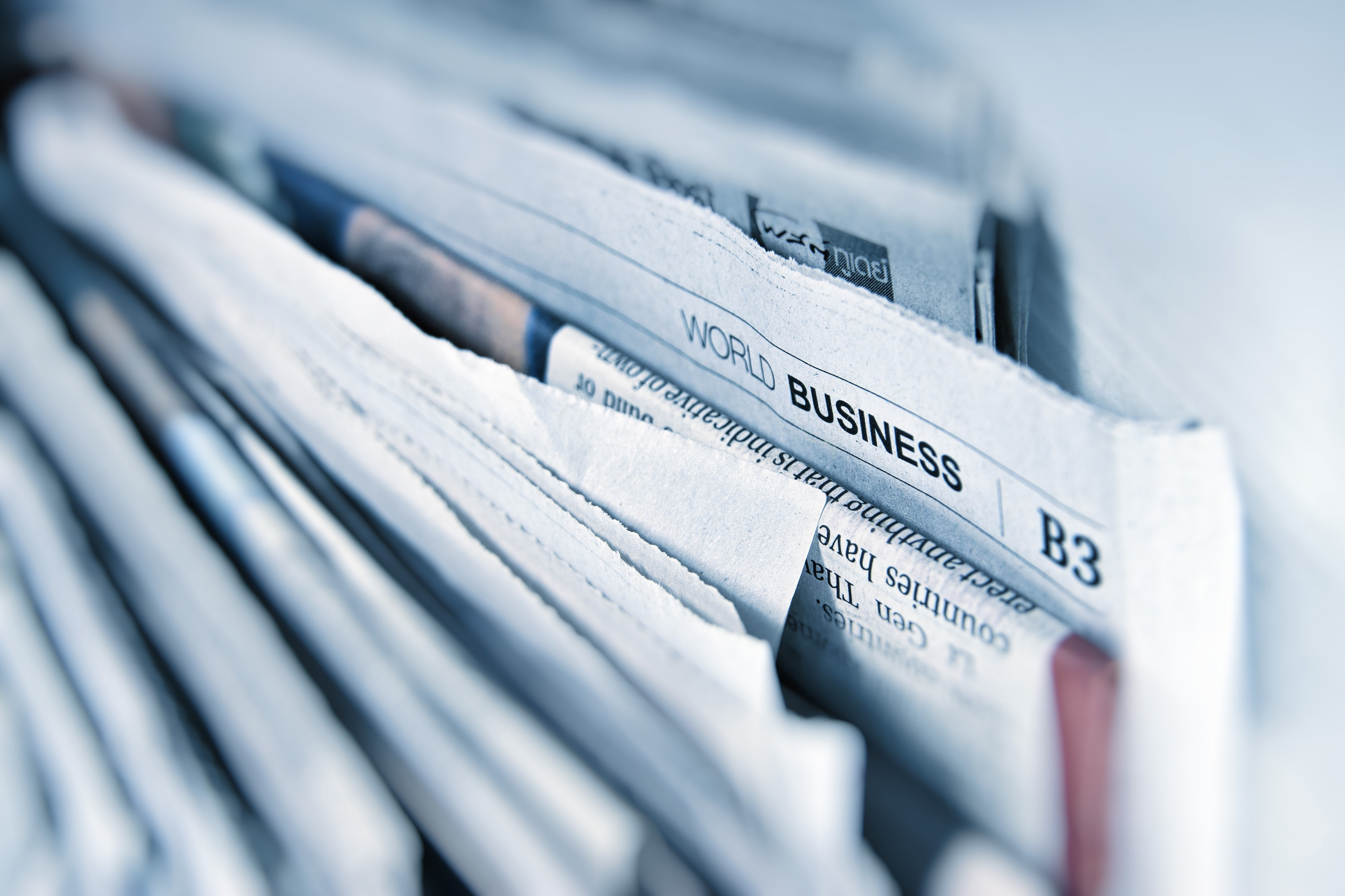 Image of the world news section of the papers
