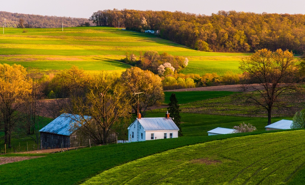 Home and barn on the farm fields and rolling hills of Southern York County, Pennsylvania.