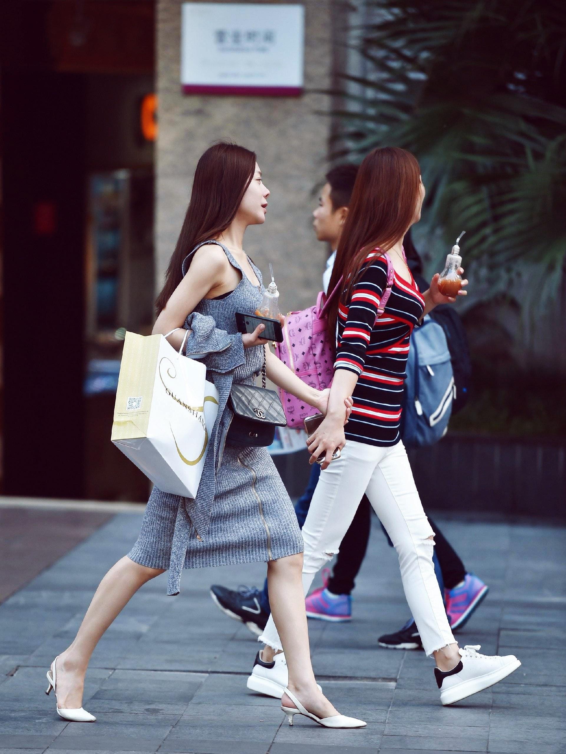 Image of women walking in Beijing