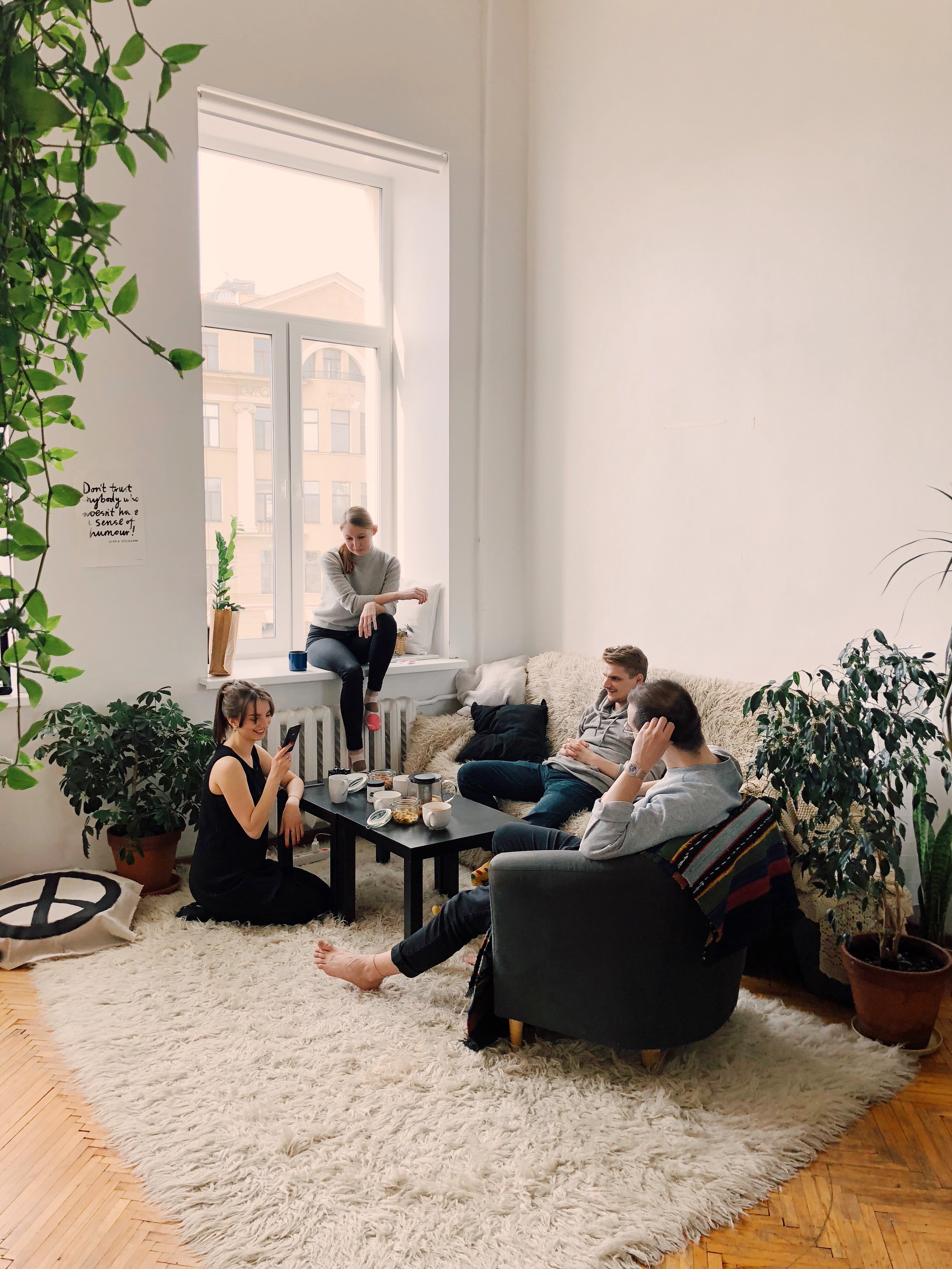 A photo of friends in an apartment