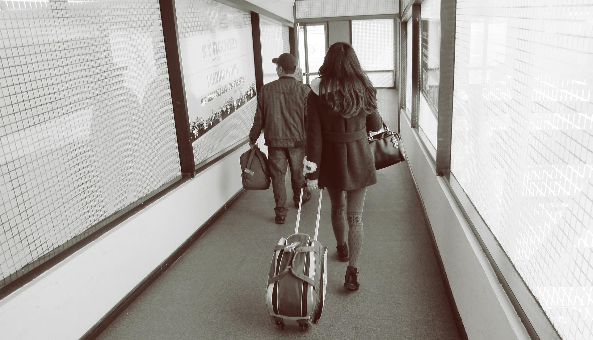 Image of people boarding an international flight