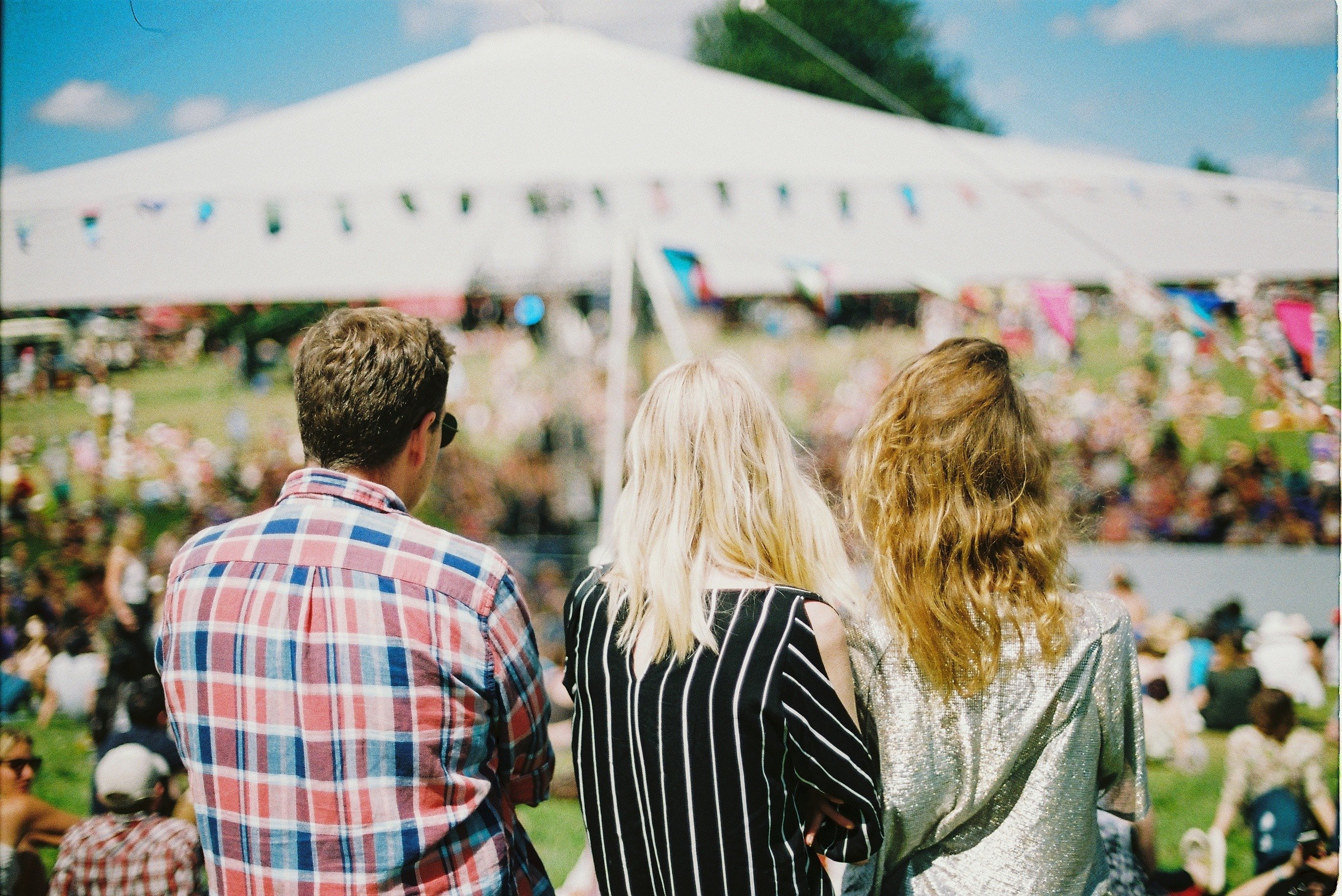 Image of friends at a festival