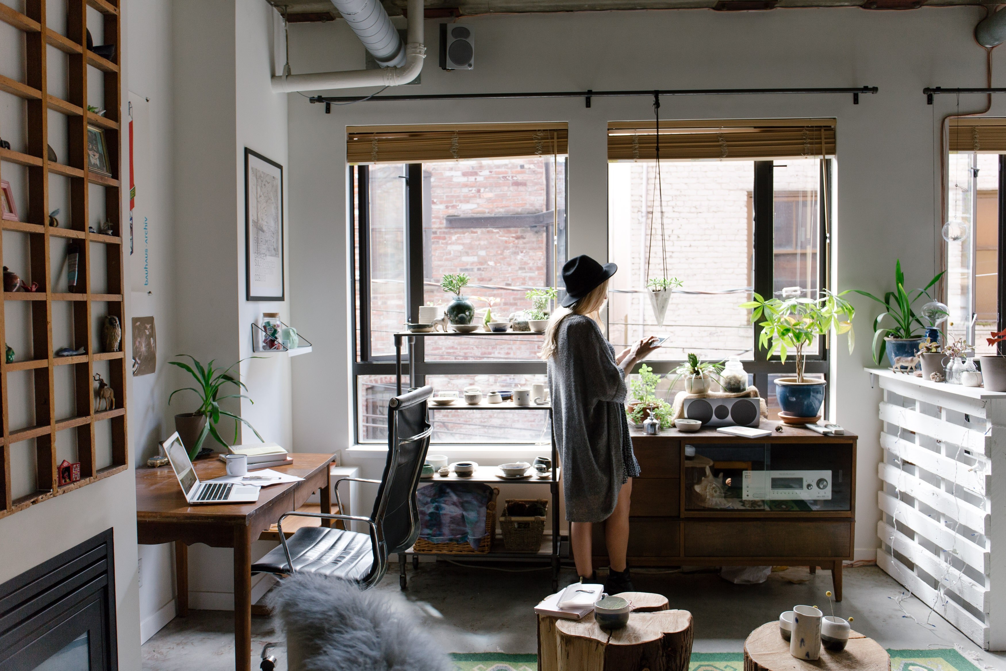 A photo of a woman in an apartment
