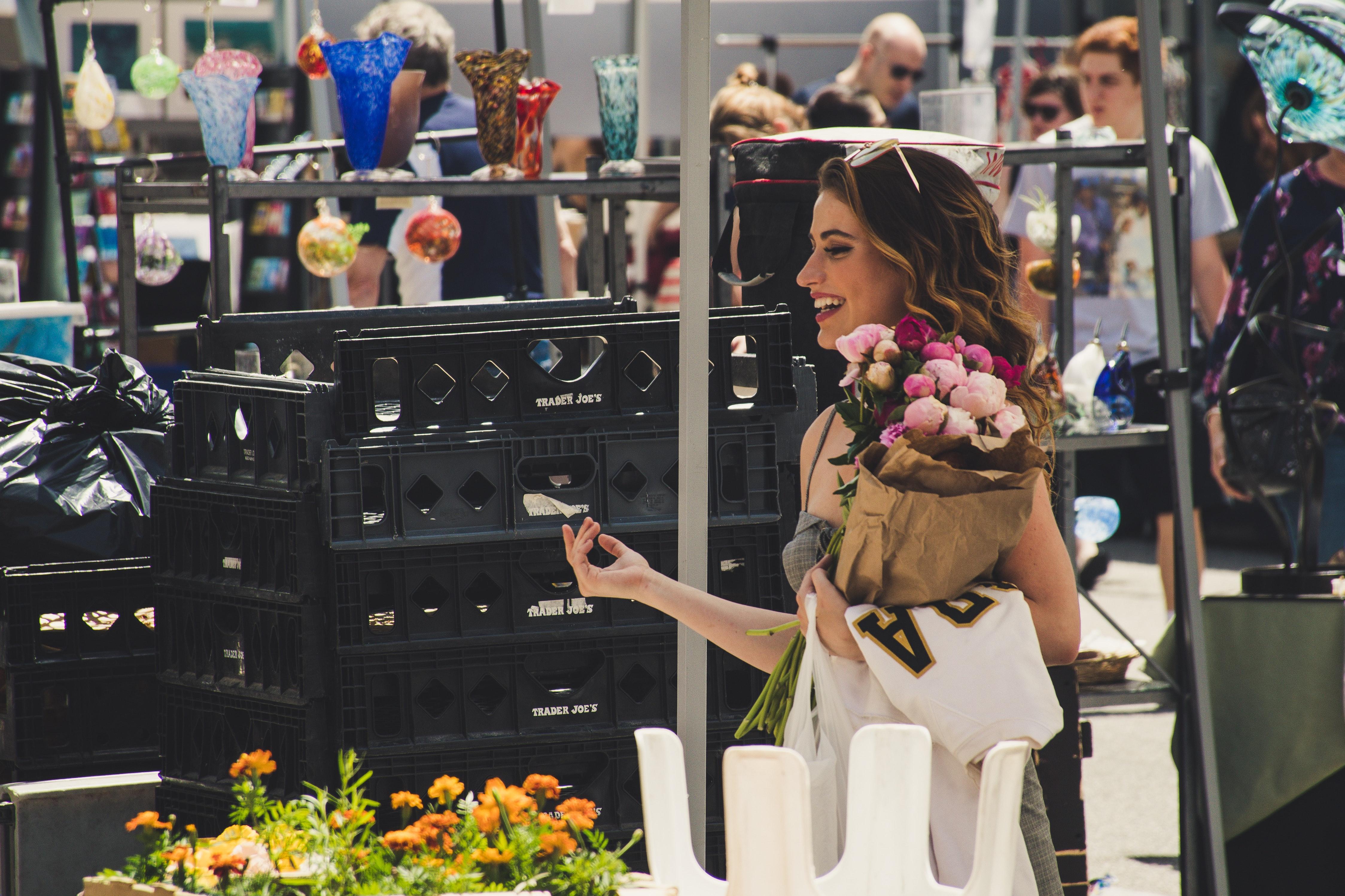Image of a woman shopping at a flea market