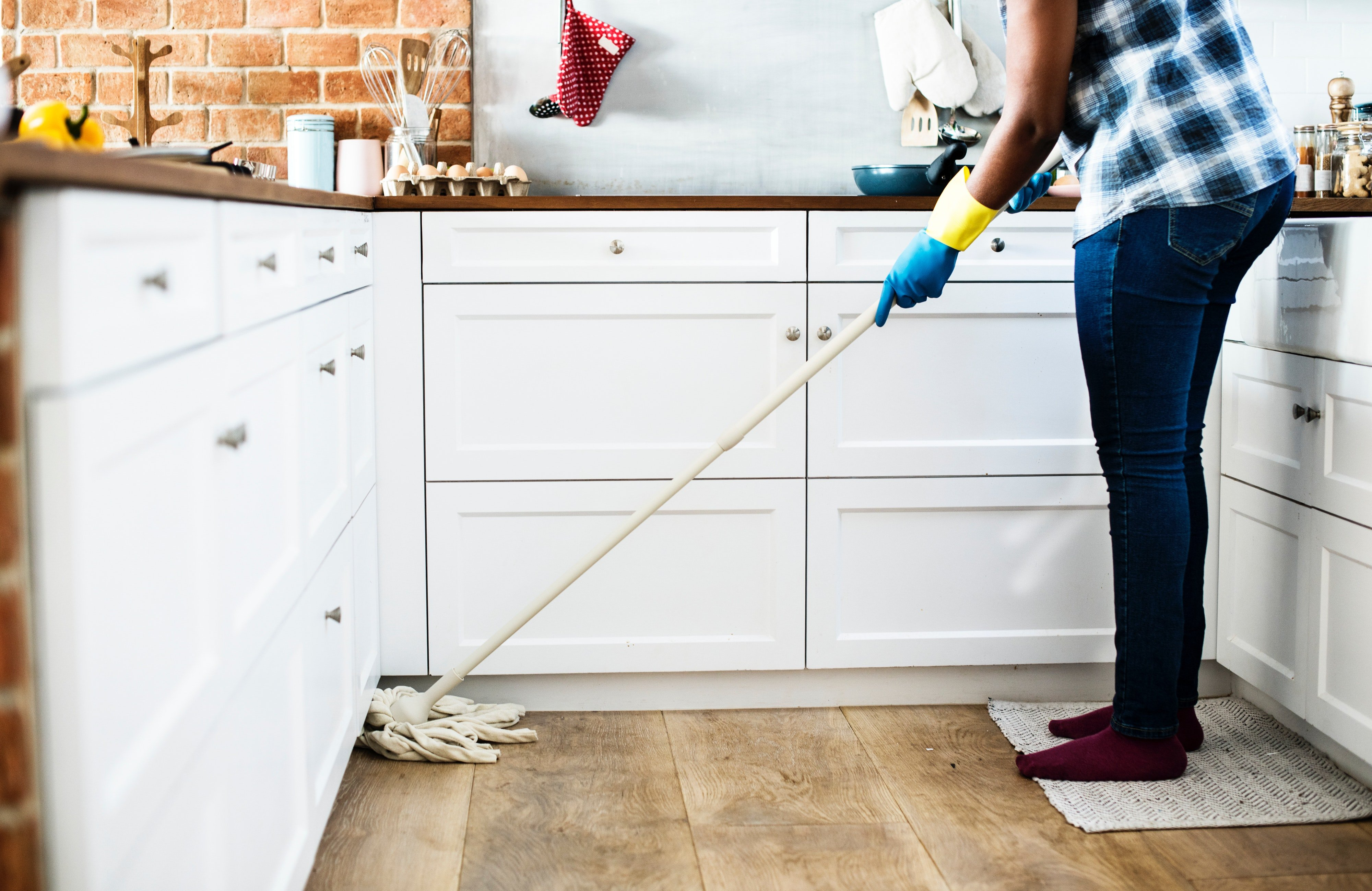 Image of a renter cleaning their home