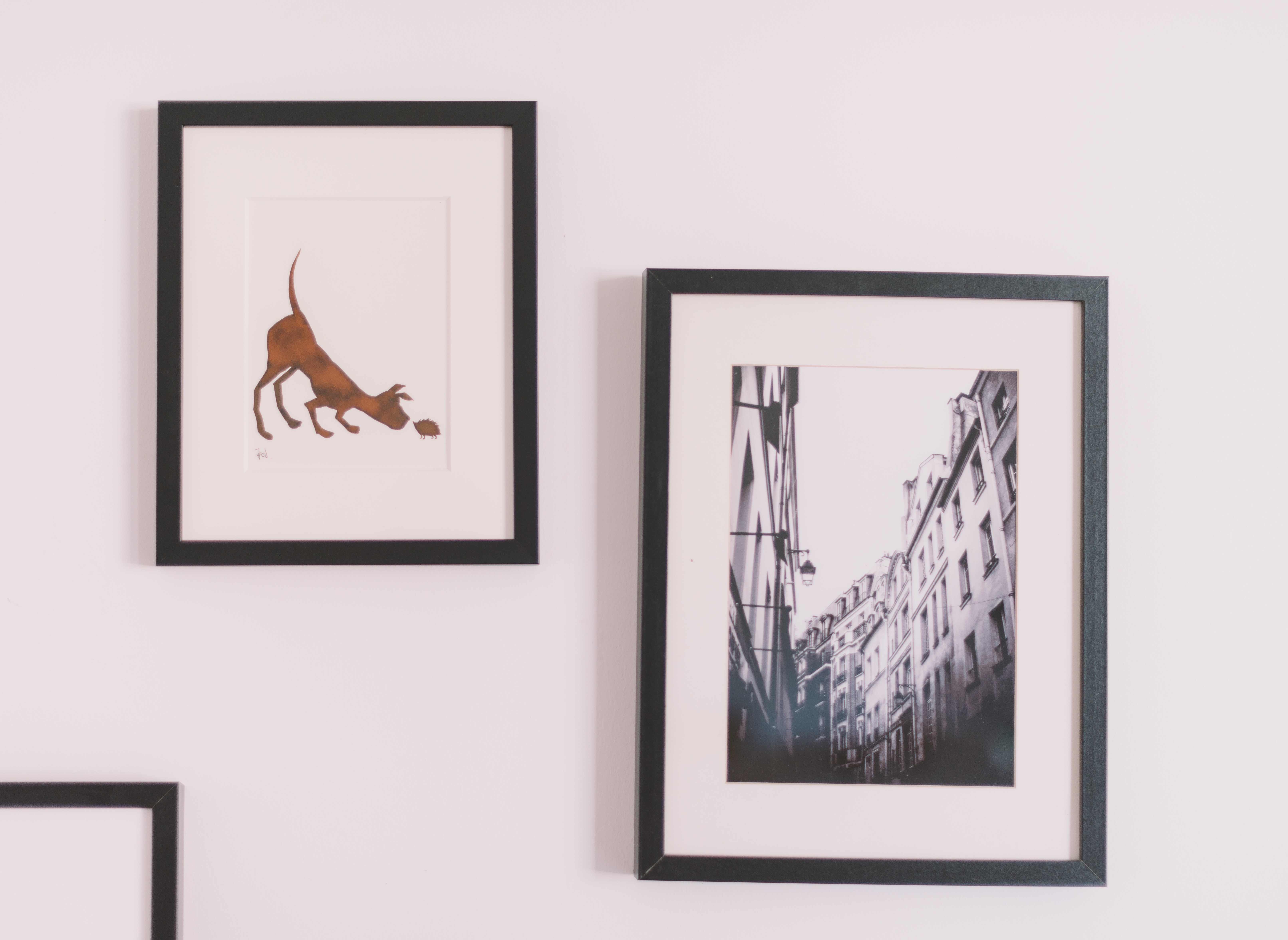 Image of framed art on an apartment wall