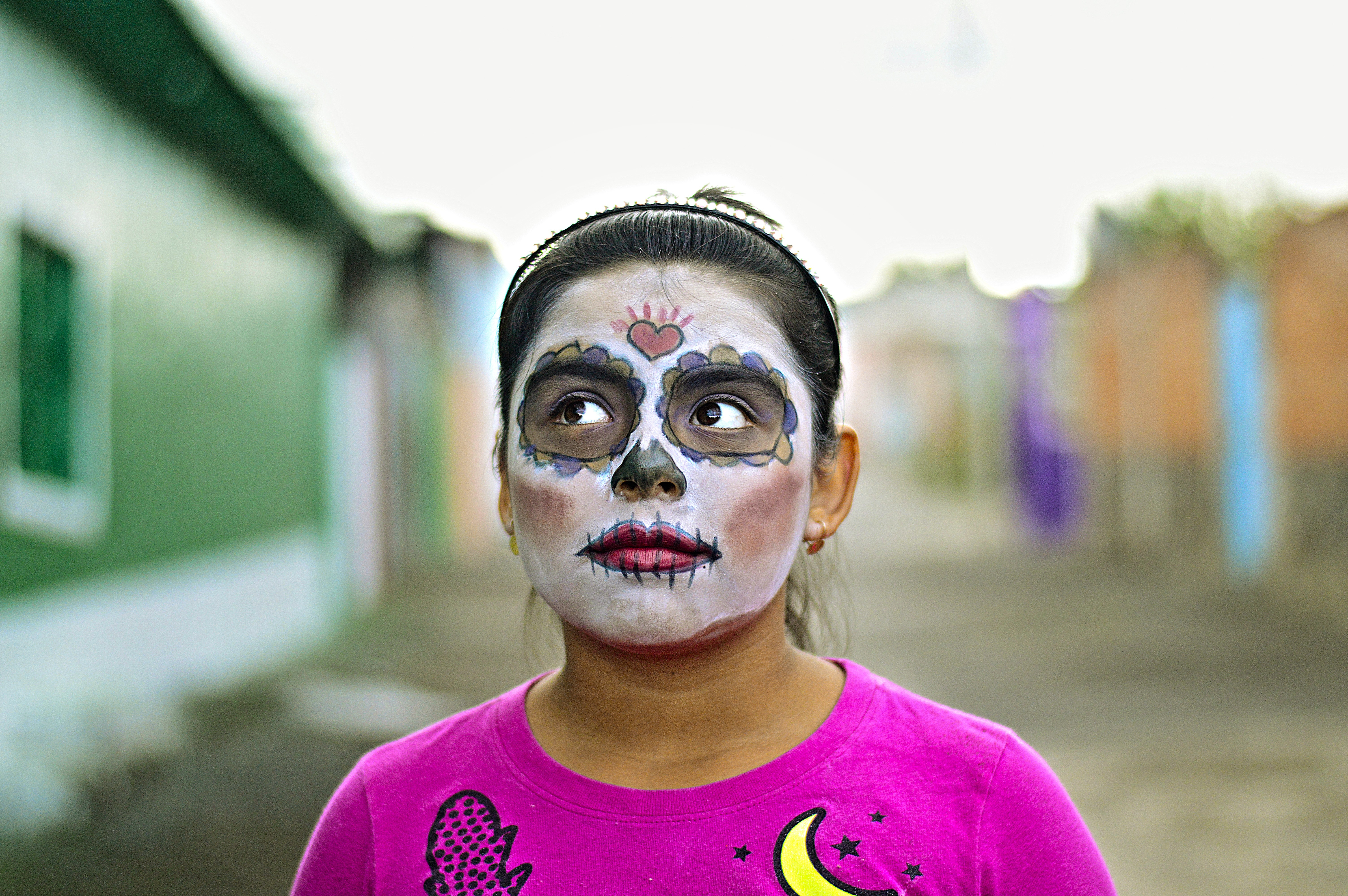Image of a girl with her face painted to celebrate Dia de Los Muertos in Mexico City