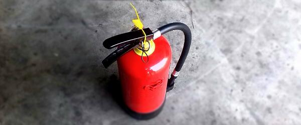 Image of a fire extinguisher, which is required in some Corporate Housing units