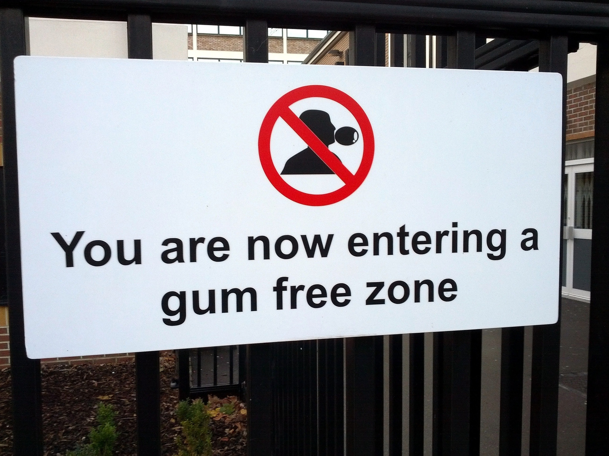 "photo of a sign with the text ""you are now entering a gum free zone"""