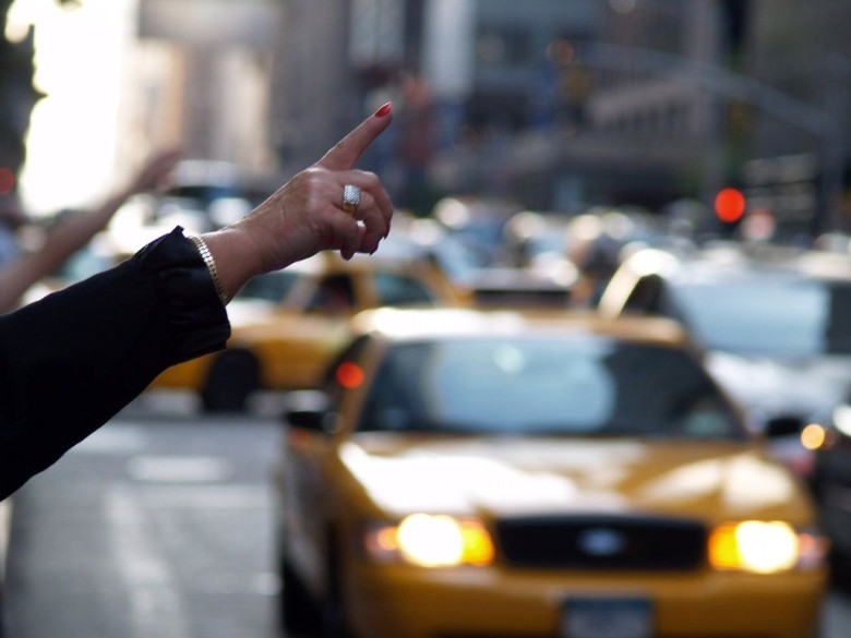 photo of someone hailing a cab