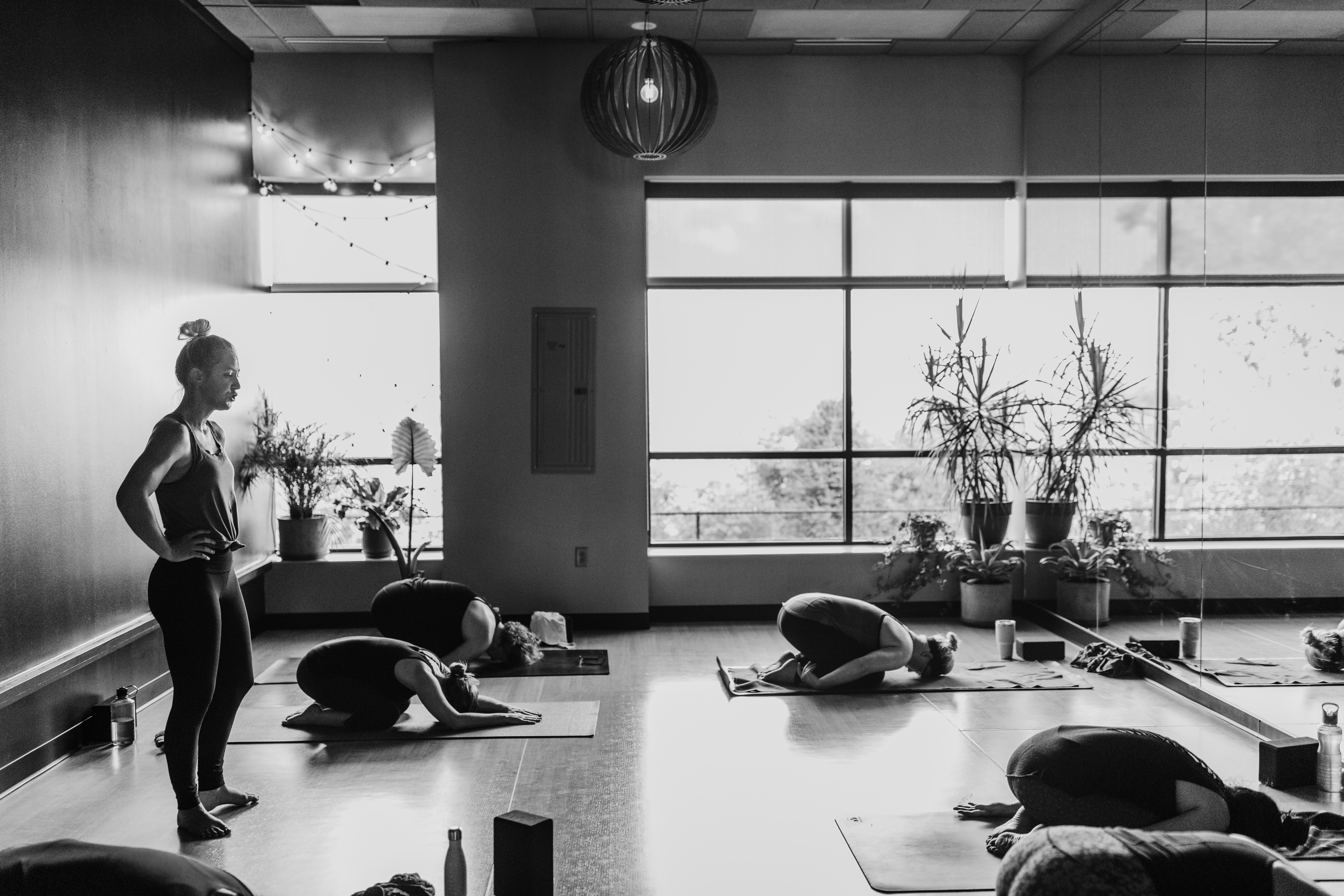Image of corporate housing residents enjoying a yoga class with locals