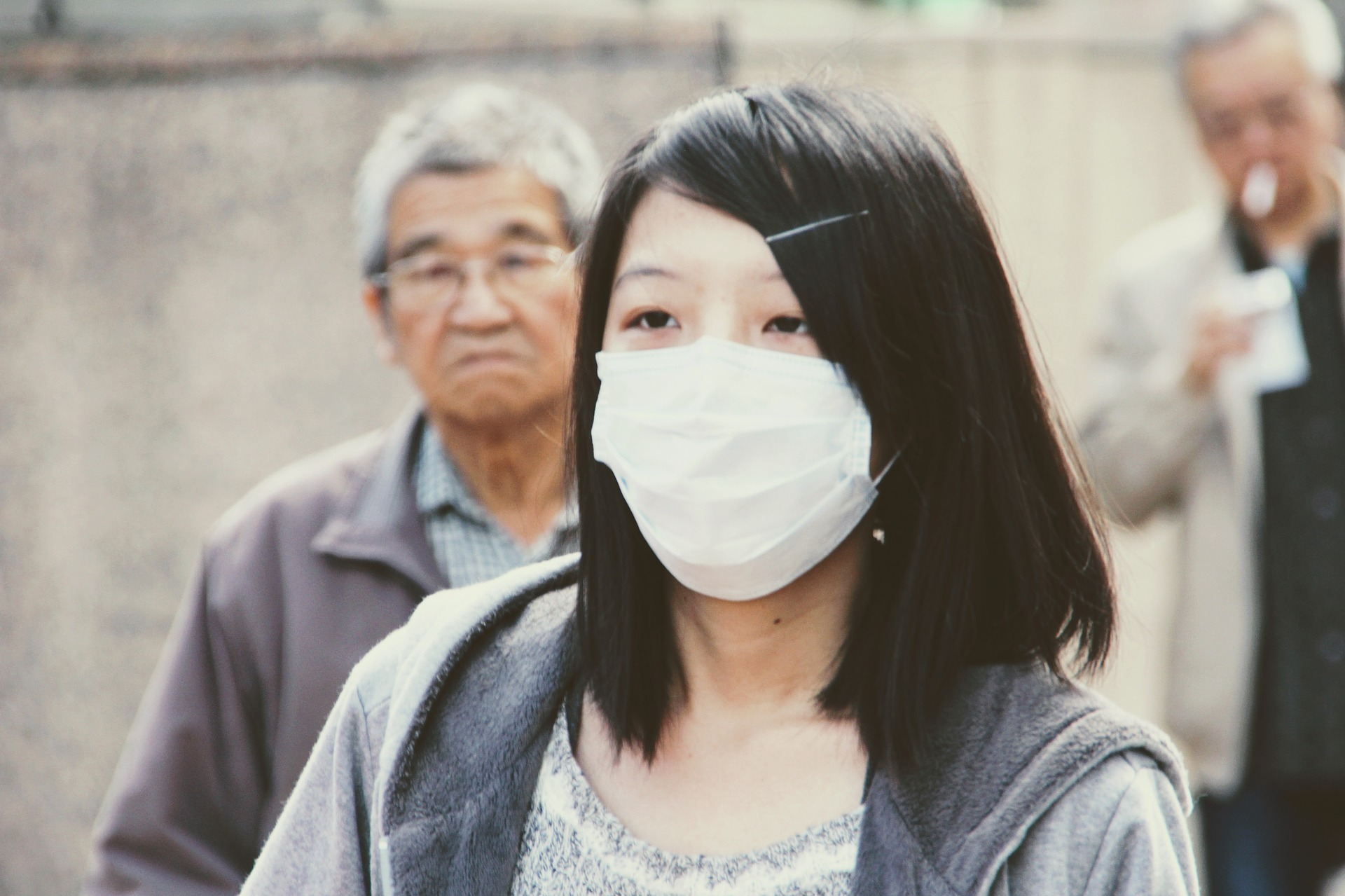 Image of a woman in China wearing a mask