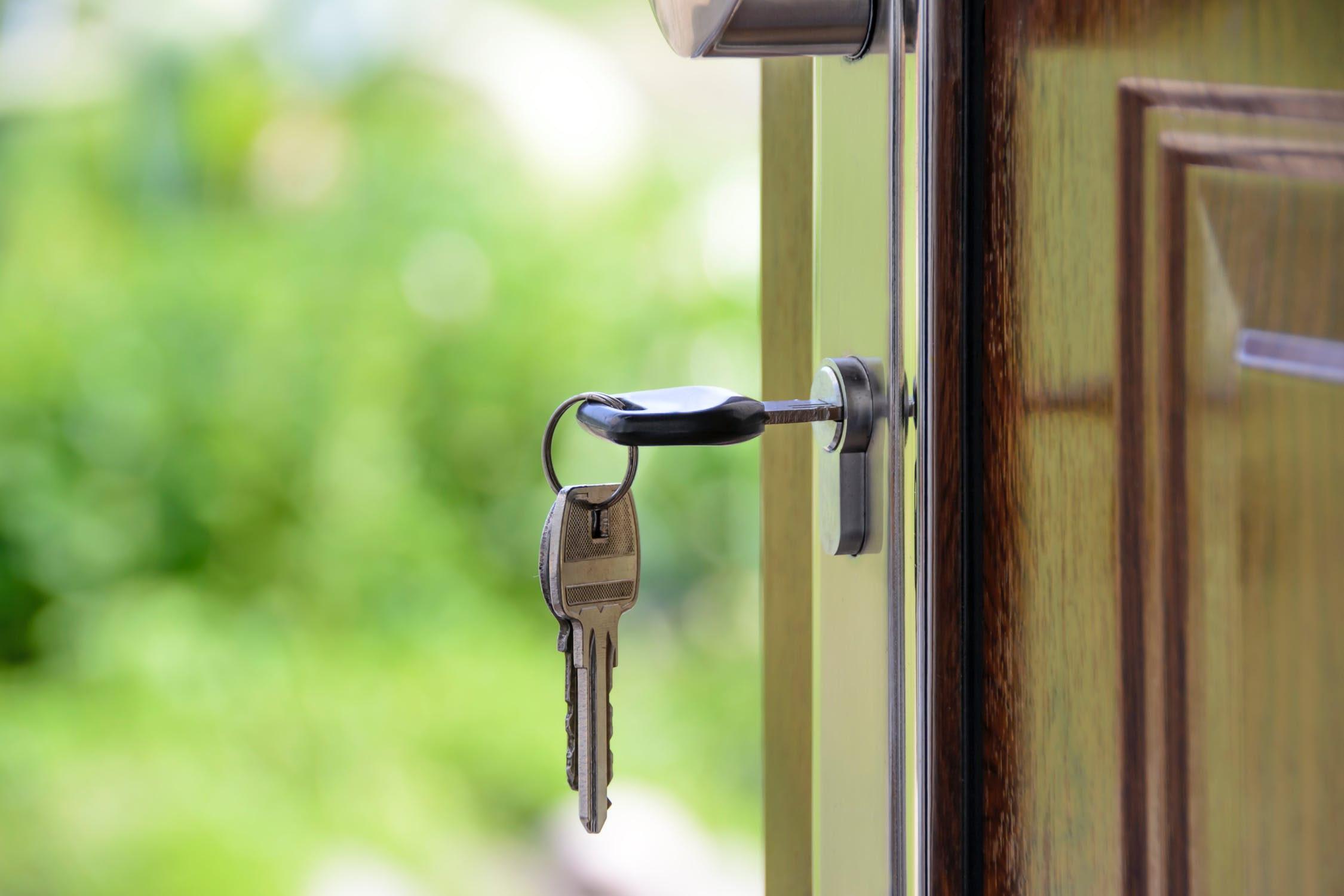 Image of keys in the keyhole of a door
