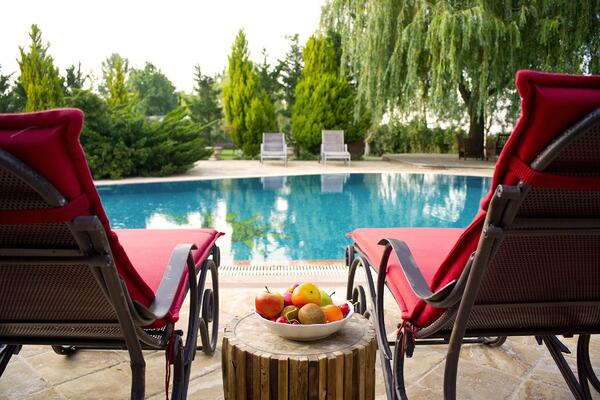 Image of a pool and lounge chairs