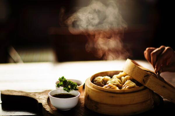 Image of dumplings in a steamer basket