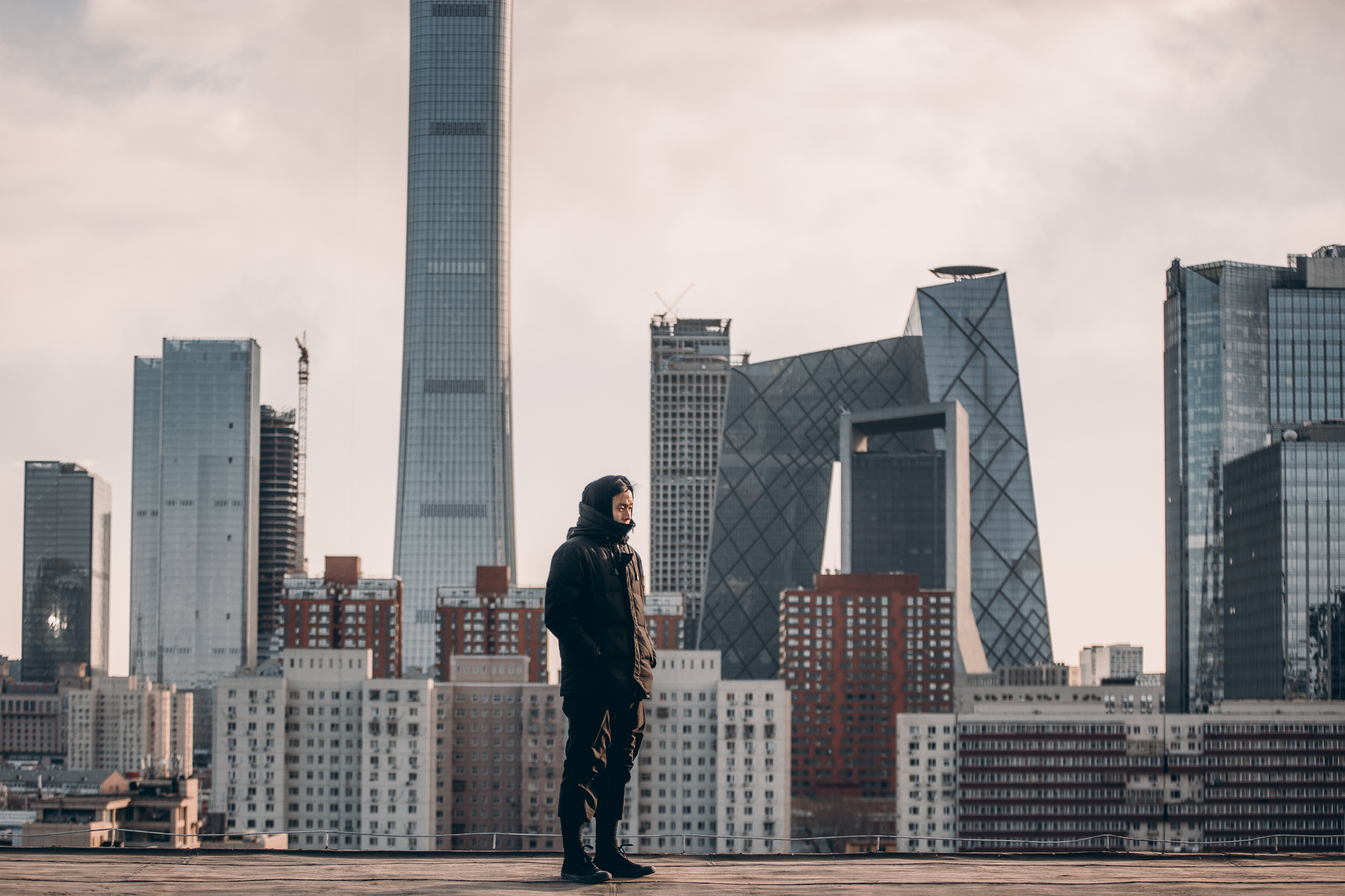 Image of a man standing in front of the Beijing skyline