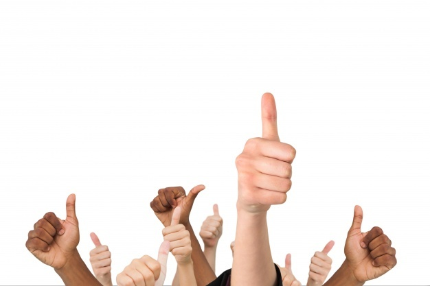 photo of a set of hands doing thumbs up sign