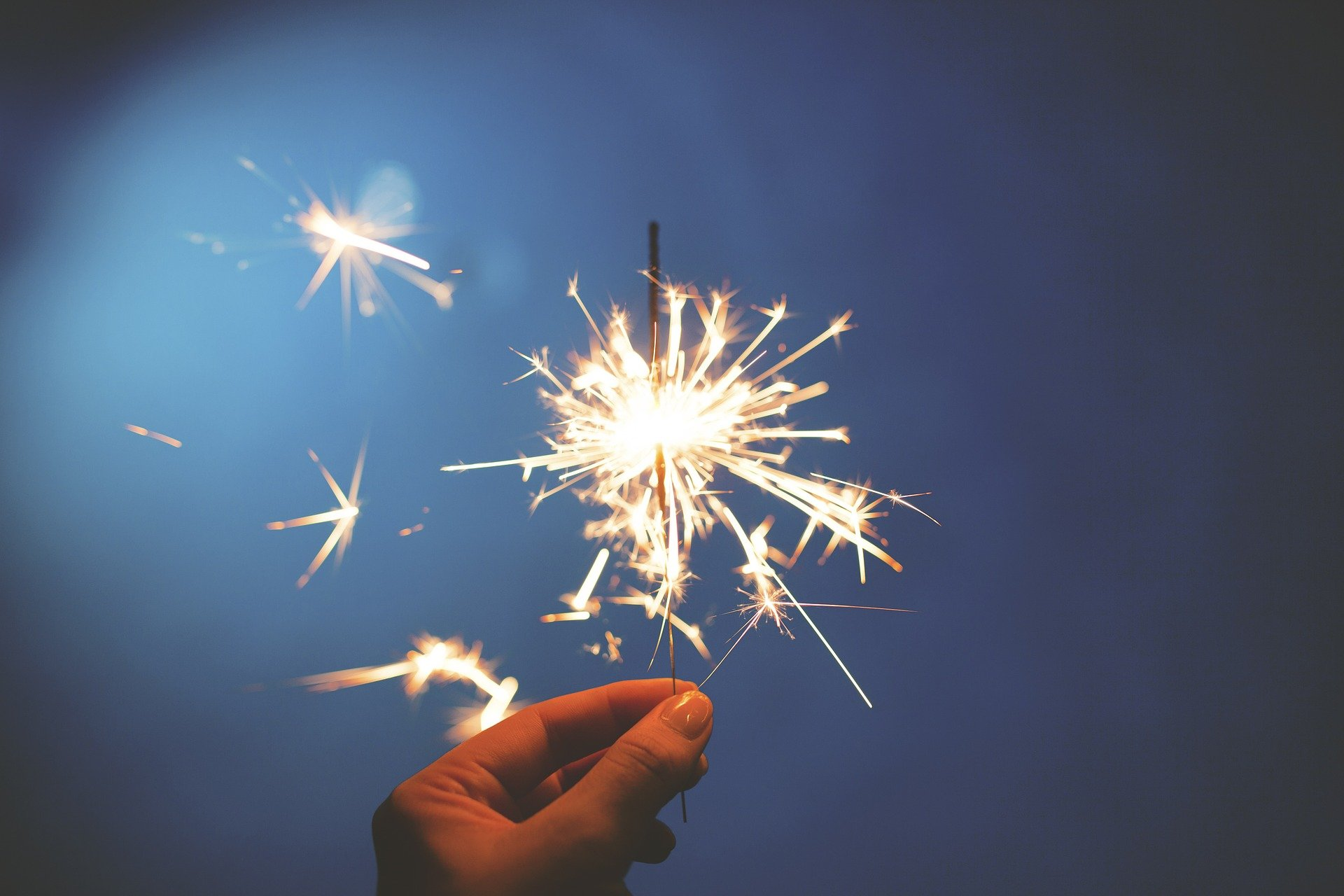 Image of a hand holding a sparkler