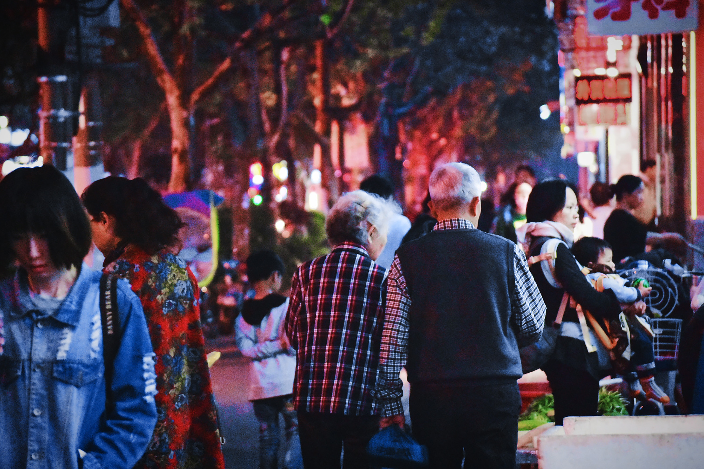 Image of people walking at night in China